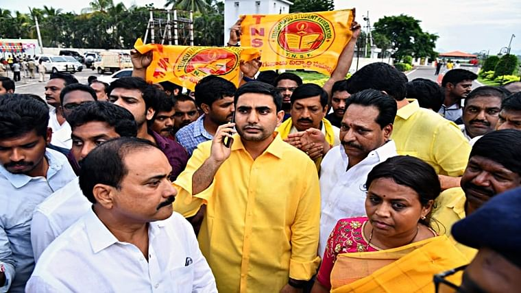 Nara Lokesh (yellow shirt), son of former CM of Andhra Pradesh N Chandrababu Naidu, as Police is not allowing him for 'Chalo Atmakur? rally, in Amaravati on Wednesday.