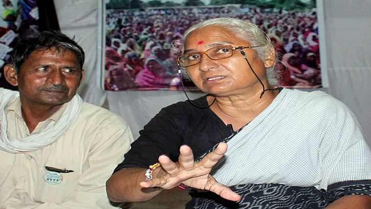 Medha Patkar talking to media persons regarding the rehabilitation and compensation of Sardar Sarovar dam oustees at the banks of river Narmada, in Bhopal