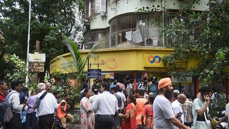 Mumbai: Customers stand outside the Punjab and Maharashtra Cooperative Bank at GTB Nagar in Mumbai
