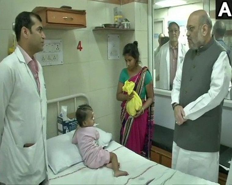 Amit Shah addressing to a doctor and patient