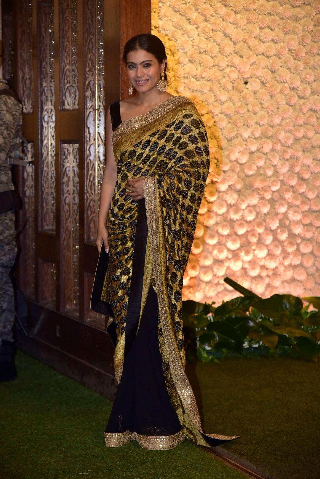 Kajol donned a Golden black saree at the Ambani's Ganpati festivaties