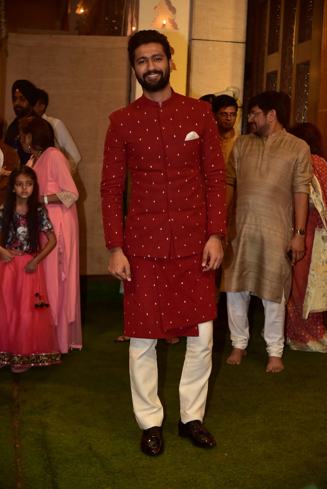 Vicky Kaushal wore a traditional red Kurta to pay his respect at the Ambanis'