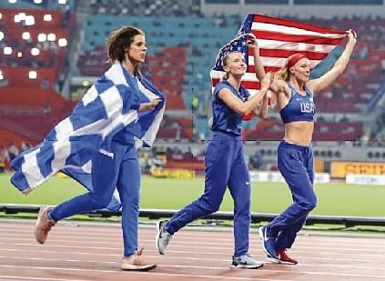 Winner Russia's Anzhelika Sidorova (C) celebrates next to USA's Sandi Morris (R) Greece's Katerina Stefanidi