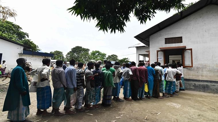 People stand in a queue to check their names on the final list of the National Register of Citizens (NRC) in an office in Pavakati village of Morigoan district