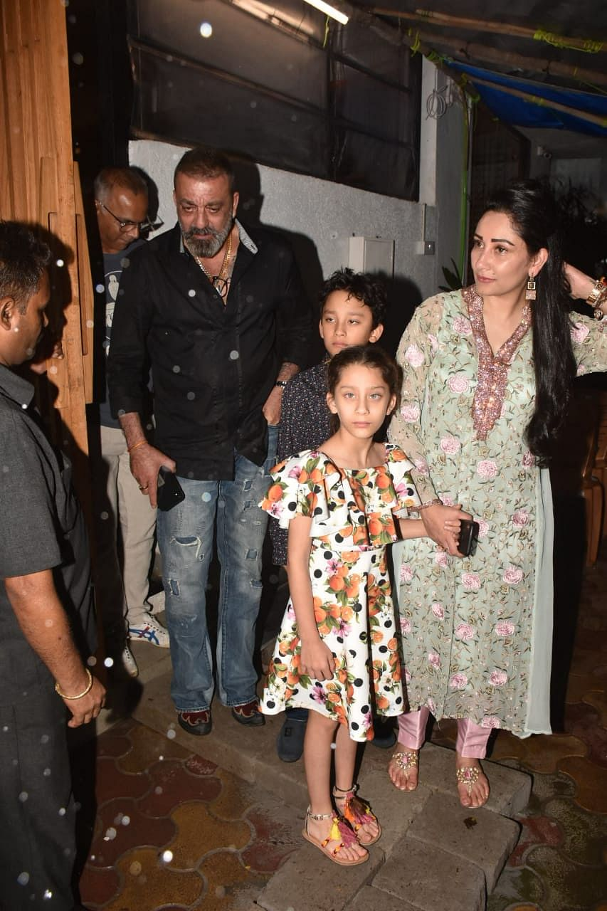 Sanjay Dutt, Manyata Dutt and kids clicked by paps in Bandra yesterday night.