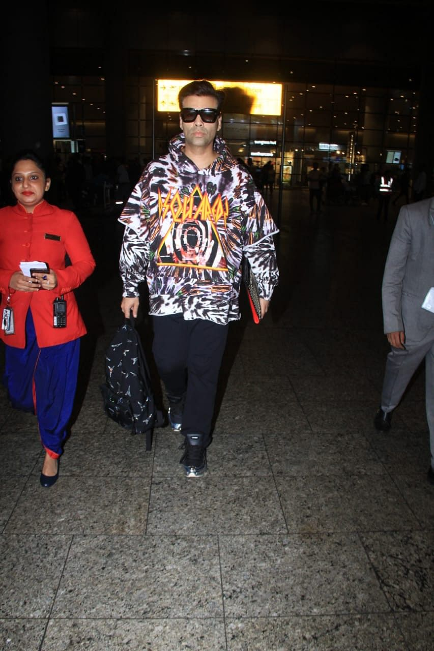 Karan Johar maintaining his uptown funk was seen in a white printed white hoodie with black pants. He carried a backpack along the ride back home.