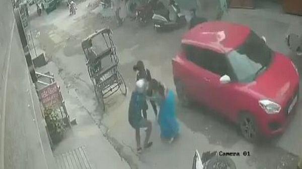 A woman fighting snatchers