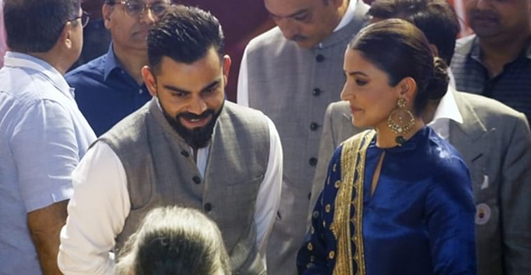 Watch Anushka Sharma kiss Virat Kohli's hand at Delhi event