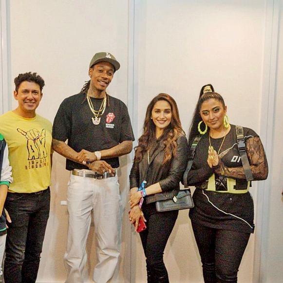 Madhuri Dixit poses with rapper Wiz Khalifa and Raja Kumari at Mumbai concert