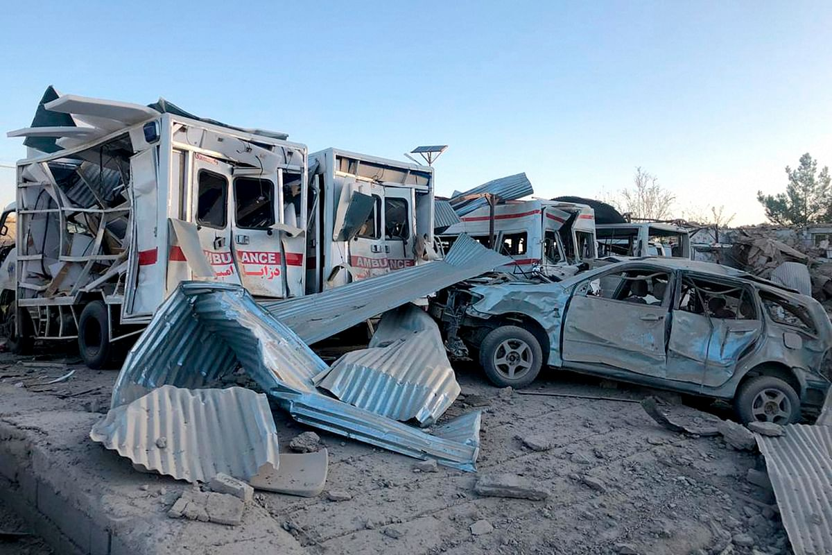 Damaged cars are seen at the site of attack in Zabul, Afghanistan, Thursday, Sept. 19, 2019