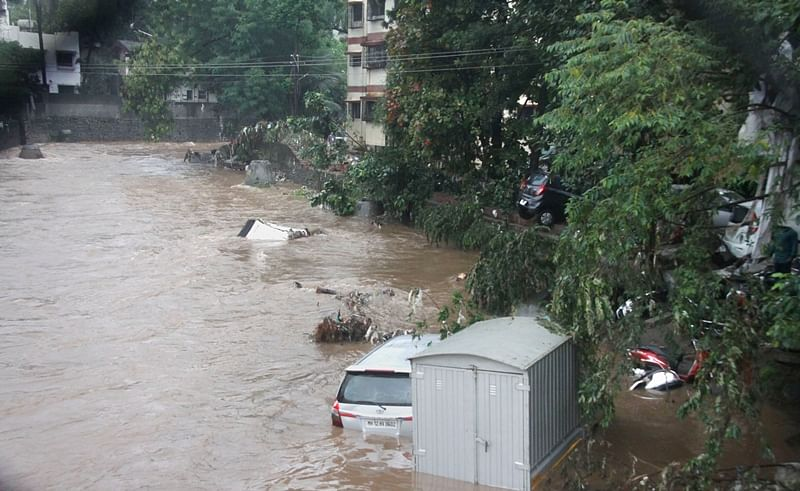 Pune: A view of vehicles washed away in floodwater following heavy rains, in Pune.