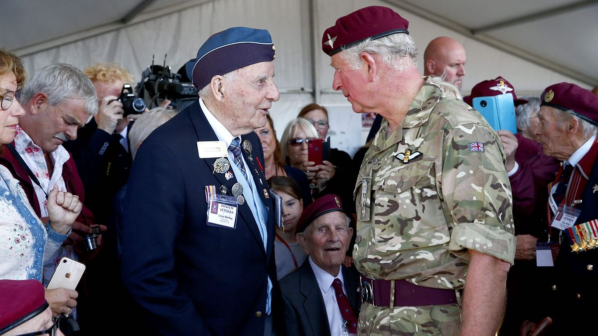 Britain's Prince Charles, Colonel in Chief of The Parachute Regiment, speaks with a veteran during a parade on the Ginkelse Heide, in the outskirts of Arnhem, on September 21, 2019