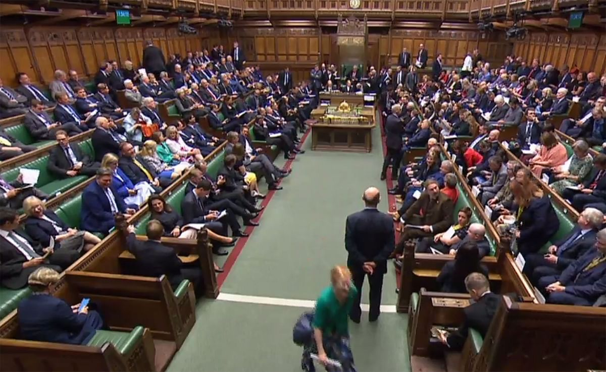 A video grab from footage broadcast by the UK Parliament's Parliamentary Recording Unit (PRU) shows members of parliament gathering in the House of Commons in central London on September 25, 2019 after parliament resumed