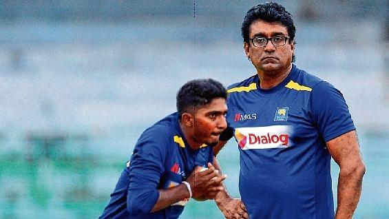 Sri Lanka's Lakshan Sandakan (L)  and coach Rumesh Ratnayake