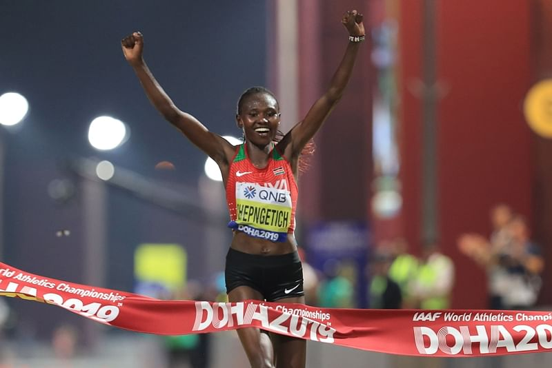 Kenya's Ruth Chepngetich celebrates after winning the Women's Marathon at the 2019 IAAF World Athletics Championships in Doha on September 27, 2019. (Photo by MUSTAFA ABUMUNES / AFP)