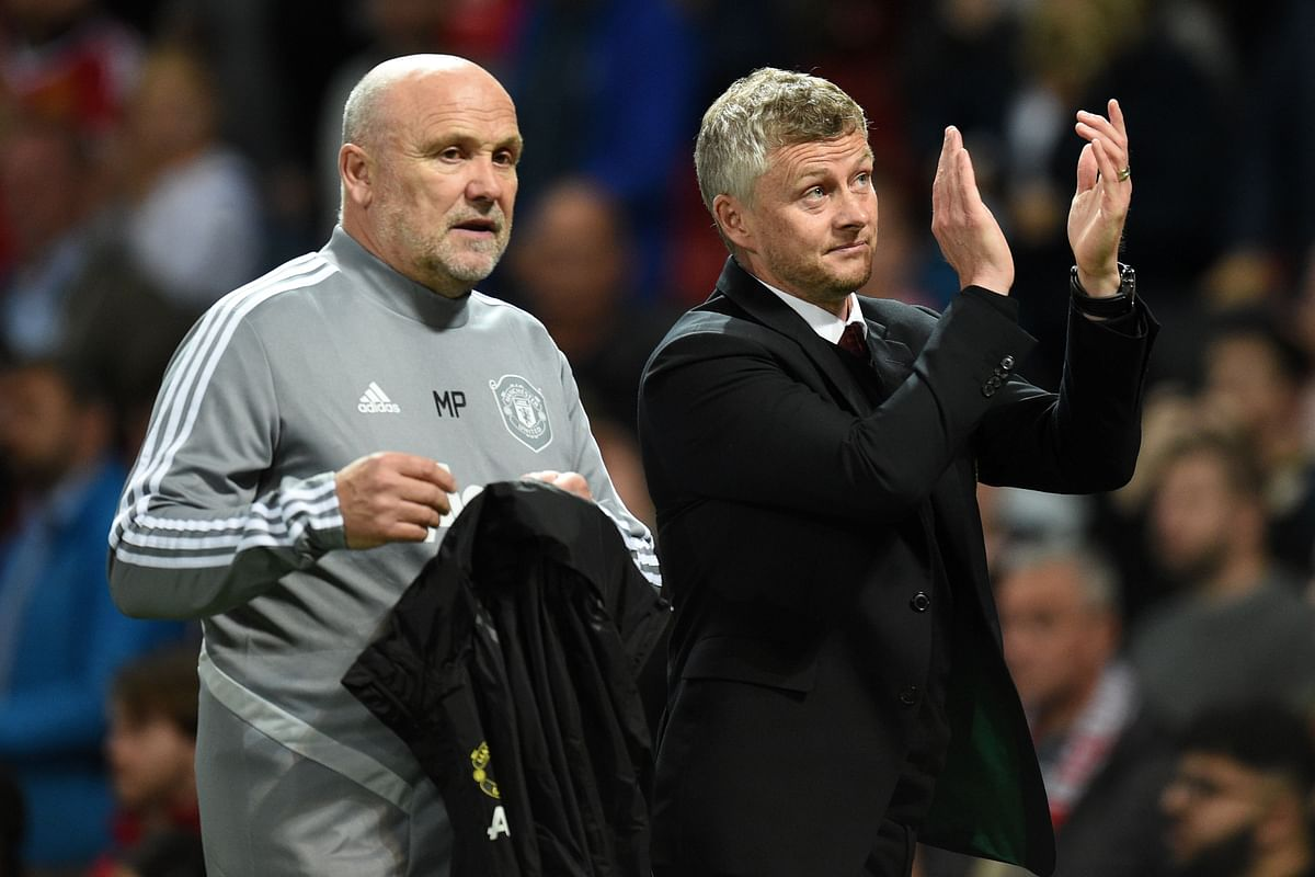 Manchester United's Norwegian manager Ole Gunnar Solskjaer (R) and Manchester United's English first-team coach Mike Phelan (L) leave the pitch after the UEFA Europa League Group L football match between Manchester United and Astana at Old Trafford in Manchester, north west England, on September 19, 2019. - Manchester United won the game 1-0.