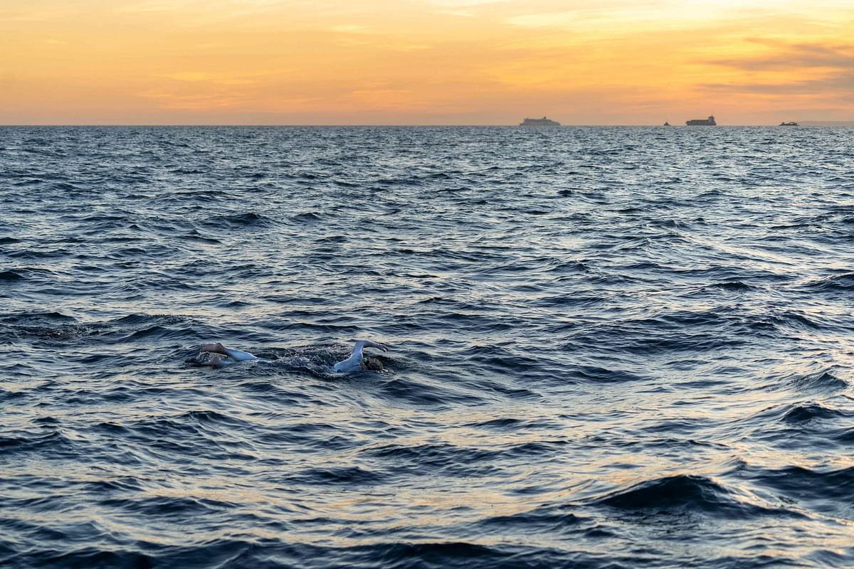 US swimmer Sarah Thomas swimming in the Dover Strait, 10 miles off the English coast, on the first leg of her non-stop four leg, 54 hour, cross-Channel swim between England and France