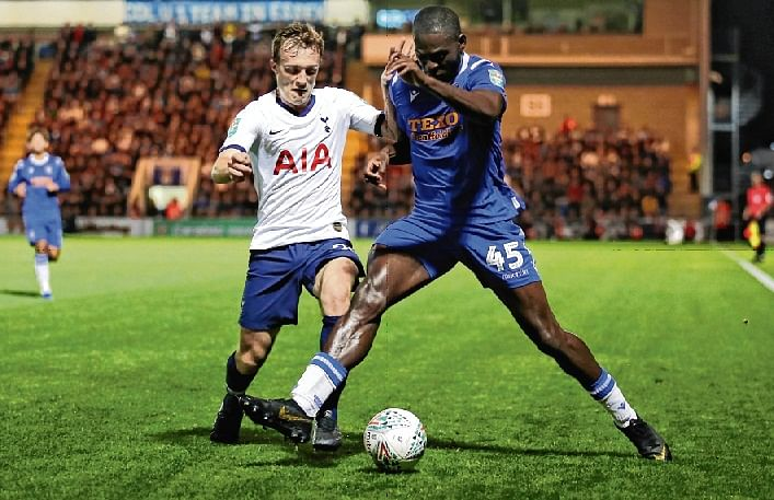 Tottenham Hotspur's English midfielder Oliver Skipp (L) vies with Colchester United's English striker Frank Nouble during their English League Cup third round football match at the Colchester Community stadium in Colchester,  on Wednesday.