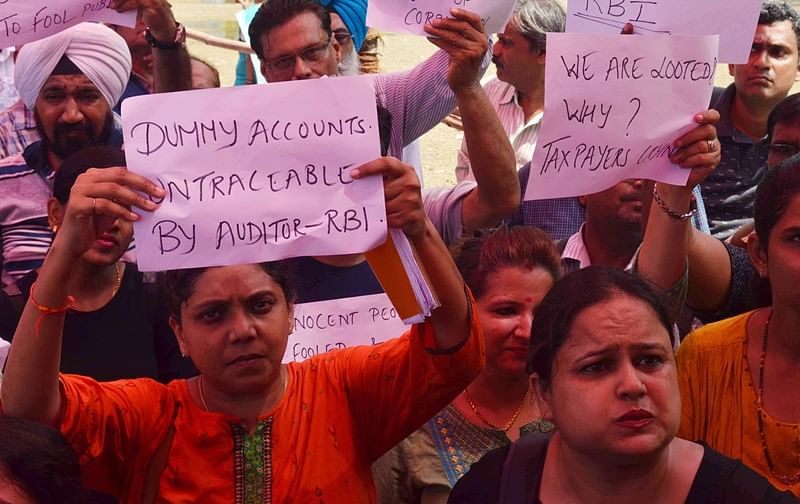 PMC account holders land outside RBI HQ