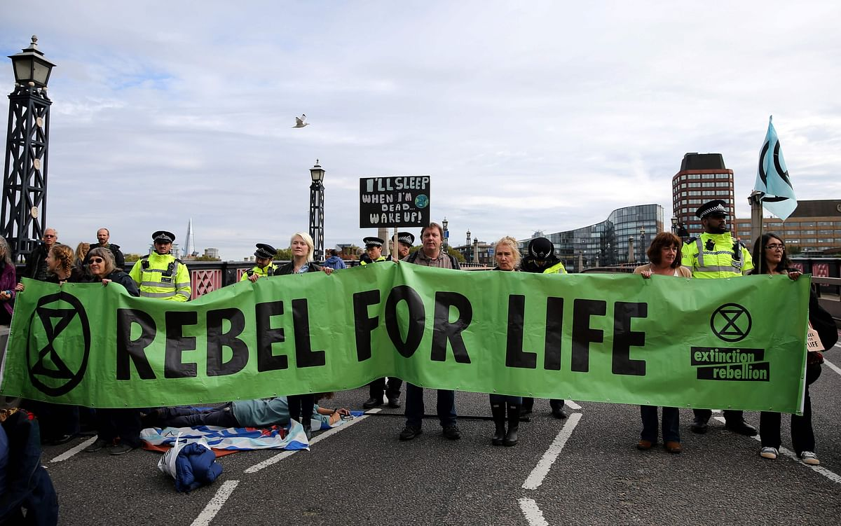 Climate change activists demonstrate on Lambeth Bridge in central London on 7 October.