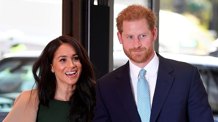 Meghan Markle (L) and Prince Harry.