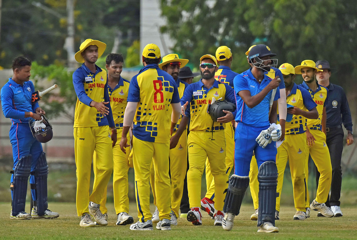 Tamil Nadu players celebrate the dismissal of a Tripura player during the Vijay Hazare Trophy match, in Jaipur, Sunda