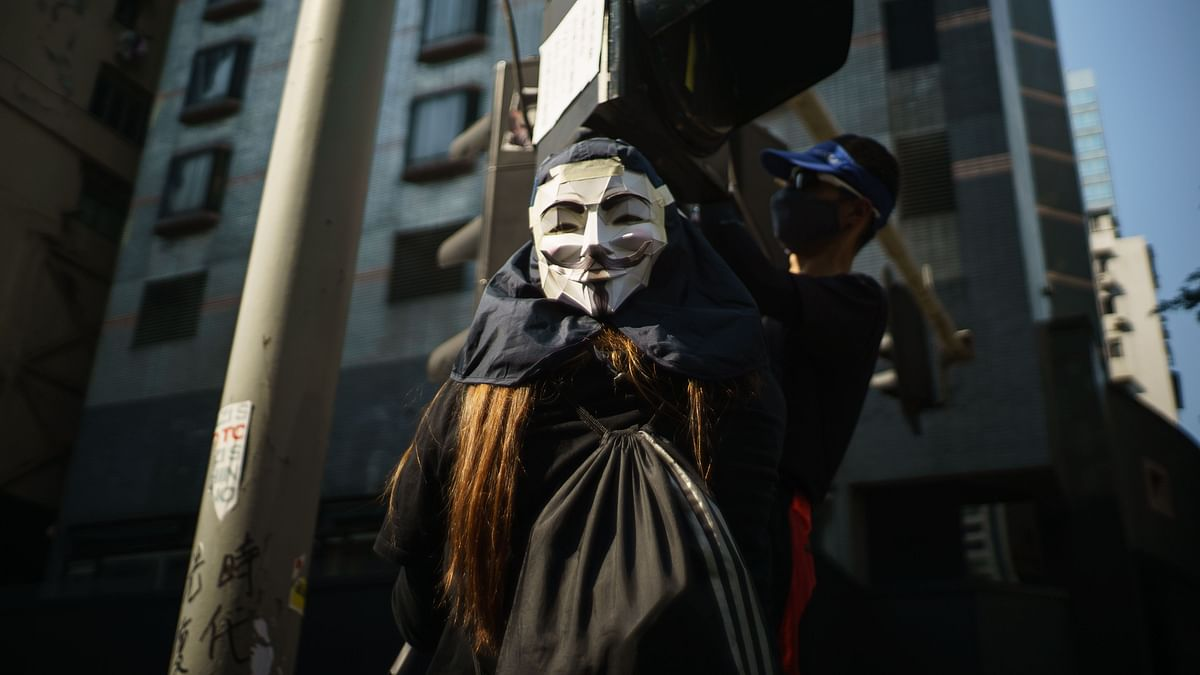 A student wears a Guy Fawkes mask during a rally at the Chinese University of Hong Kong