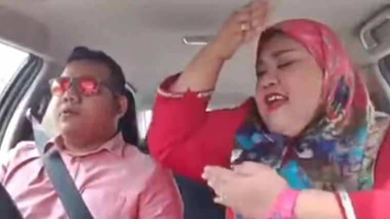 Woman lip syncs to 'Bole Chudiyan' in moving car, netizens say husband deserves National Award for being patient