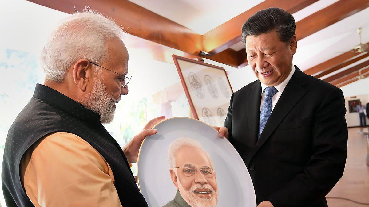 Mamallapuram: Prime Minister Narendra Modi and Chinese President Xi Jinping exchange gifts, at Mamallapuram , Saturday, Oct. 12, 2019