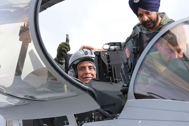 Bordeaux:  Indian Defense Minister Rajnath Singh thumbs up as he sits in a Rafale jet fighter during an handover ceremony at the Dassault Aviation plant in Merignac, near Bordeaux, southwestern France, Tuesday, Oct. 8, 2019. France has delivered to India its first Rafale fighter jet from a series of 36 aircraft purchased in a multi-billion dollar deal in 2016. AP/PTI Photo(AP10_8_2019_000240B)