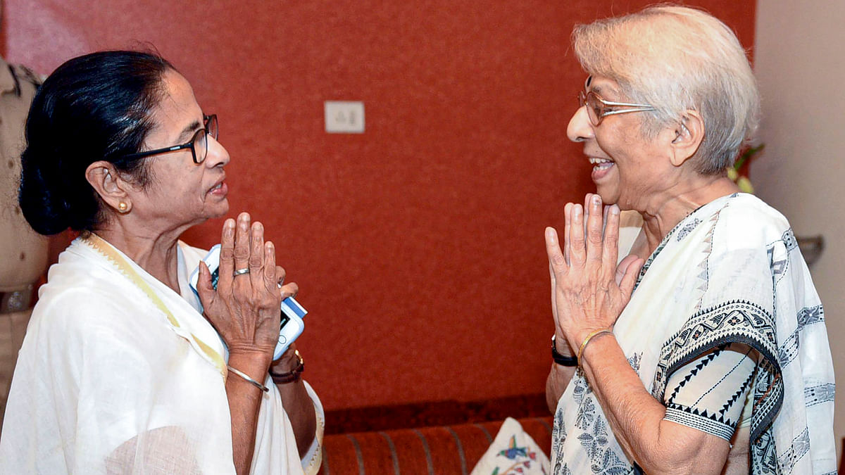West Bengal Chief Minister Mamata Banerjee exchanges greetings with Nirmala Banerjee, mother of Indian-American Nobel Prize winning economist Abhijit Banerjee, in Kolkata, Wednesday