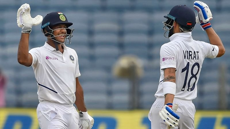 Pune: Indian cricketer Mayank Agarwal celebrates his century with teammate Virat Kohli during the second India-South Africa cricket test match at Maharashtra Cricket Association Stadium in Pune, Thursday, Oct. 10, 2019. (PTI Photo/Mitesh Bhuvad)(PTI10_10_2019_000079B)