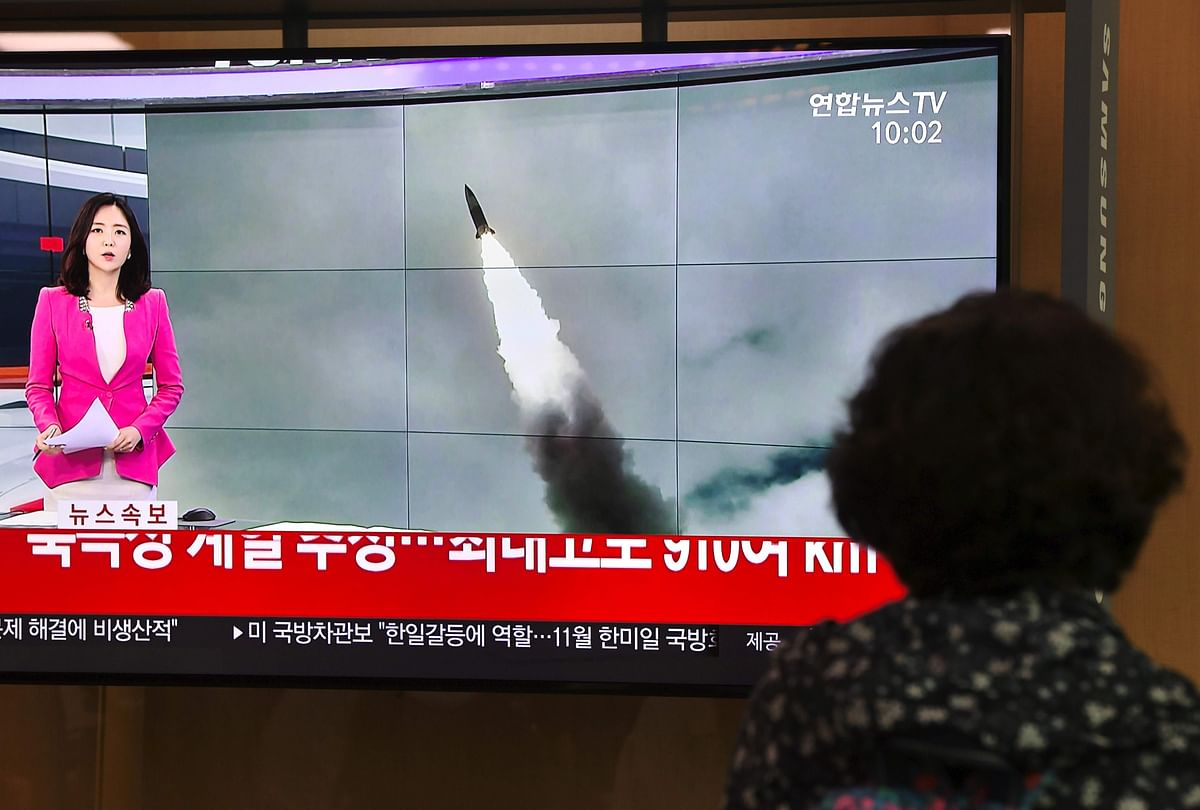 A woman watches a television news screen showing file footage of a North Korean missile launch, at a railway station in Seoul on October 2, 2019