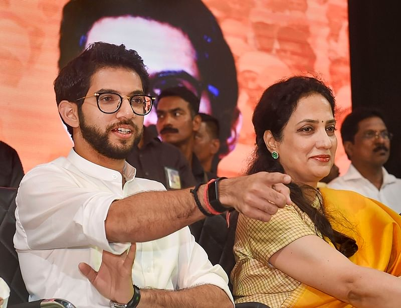 Mumbai: Yuva Sena chief Aaditya Thackeray, the elder son of party chief Uddhav Thackeray, seated with his mother Rashmi during a rally to announce his candidature from Worli seat for upcoming Maharashtra Assembly elections, in Mumbai, Monday, Sept. 30, 2019. Aaditya will become the first member of the Thackeray clan ever to contest an election. (PTI Photo/Shashank Parade) (PTI9_30_2019_000266B)