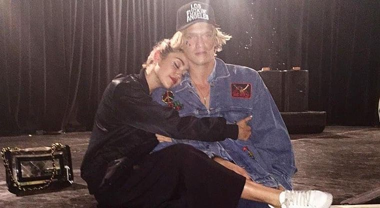 Miley Cyrus shares a 'quick kiss' with Cody Simpson after breakup with Kaitlynn Carter