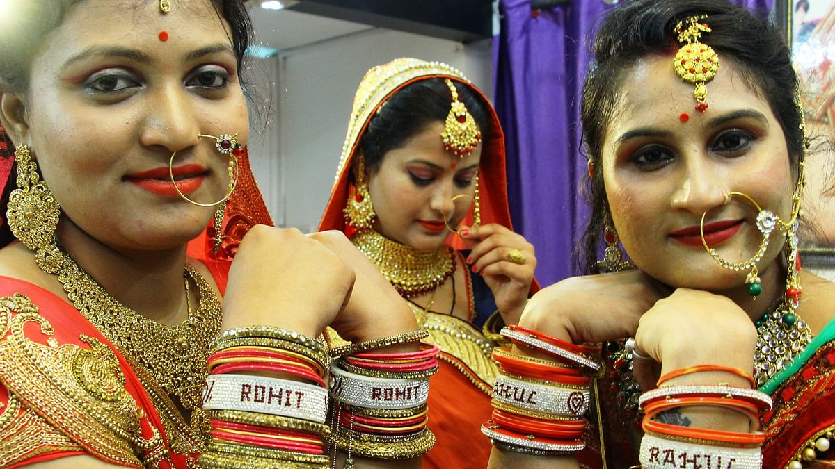 Women showing off their personalised bangles