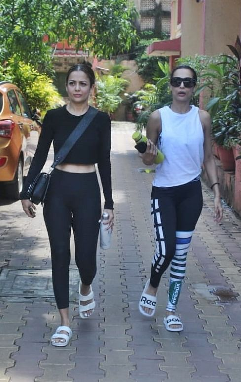 Arora sisters outside Diva Yoga center in Bandra