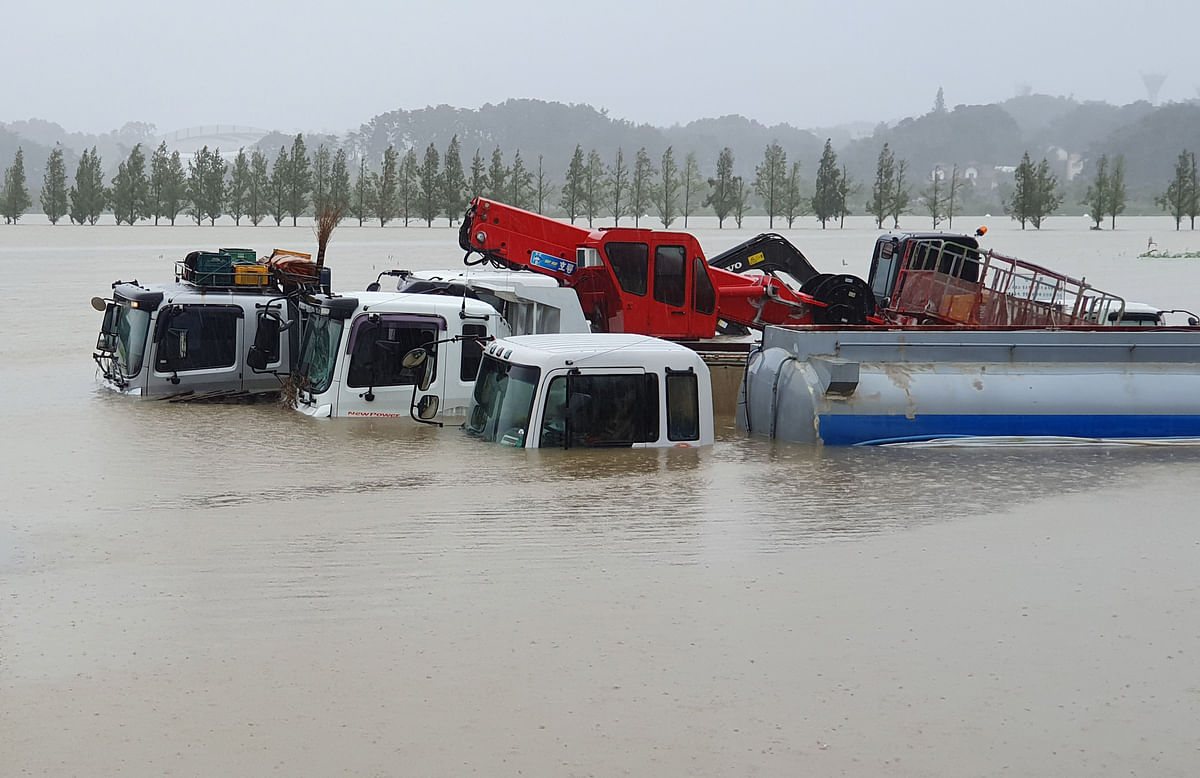 Trucks and vehicles are seen inundated by floodwaters from heavy rains caused by Typhoon Mitag in Gangneung.