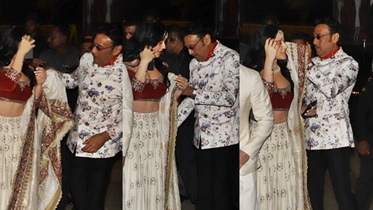 Taking care of his cub: Jackie helps daughter Krishna with her dupatta during Bachchans' Diwali bash