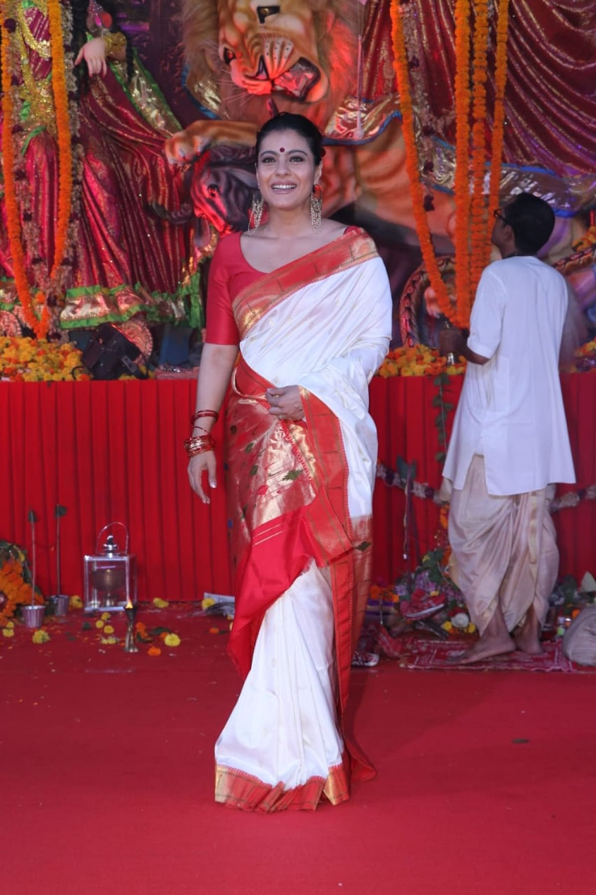 Kajol is one of the famous Bengali actress in Bollywood. She visits North Bombay Sarbojanik Durga Puja pandal in Mumbai every year. Kajol who is half-Bengali, is often seen distributing bhog as well.