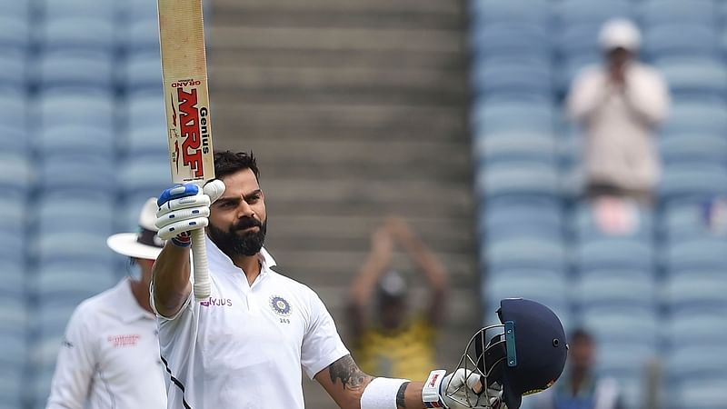 Pune: Indian cricket team Captain Virat Kohli raises his bat after scoring a century on the day 2 of second India-South Africa cricket test match, at Maharashtra Cricket Association Stadium in Pune, Friday, Oct. 11, 2019. (PTI Photo/Mitesh Bhuvad)