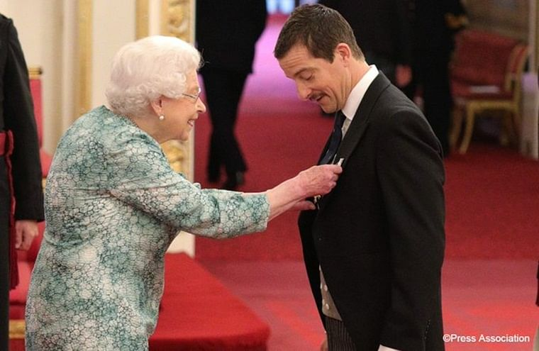 Bear Grylls receives OBE for services to young people, the media and charity
