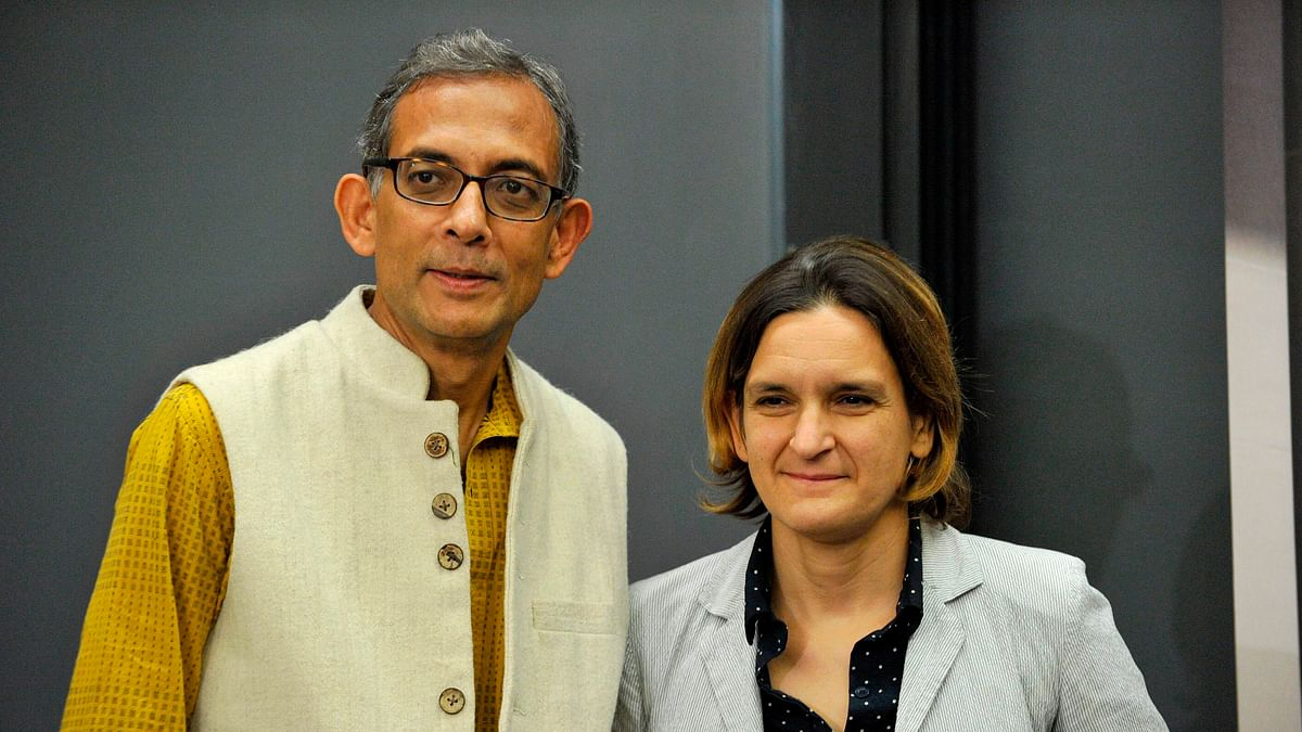 Nobel Prize winners in economics, Abhijit Banerjee and Esther Duflo stand together after giving a press conference at the Massachusetts Institute of Technology (MIT) in Cambridge, Massachusetts.