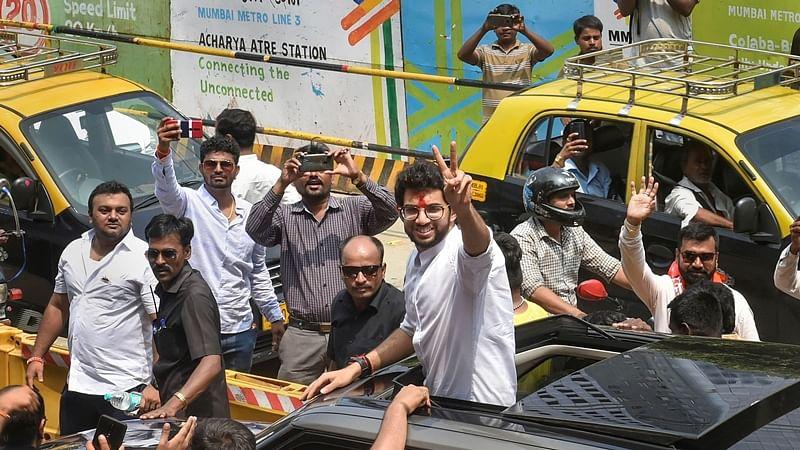 Mumbai: Yuva Sena President Aditya Thackeray greets his supporters after he filed his nominations papers from Worli for upcoming Maharashtra Assembly elections, in Mumbai, Thursday, Oct. 3, 2019. (PTI Photo/Mitesh Bhuvad)(PTI10_3_2019_000078B)