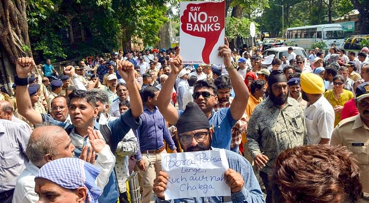 PMC Bank customers staged a protest outside the Killa Court on October 14, 2019