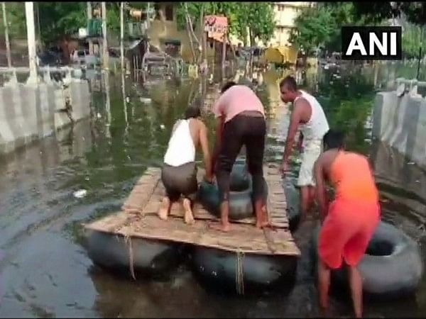 Bihar Floods: Locals construct makeshift boat to travel through streets Patna