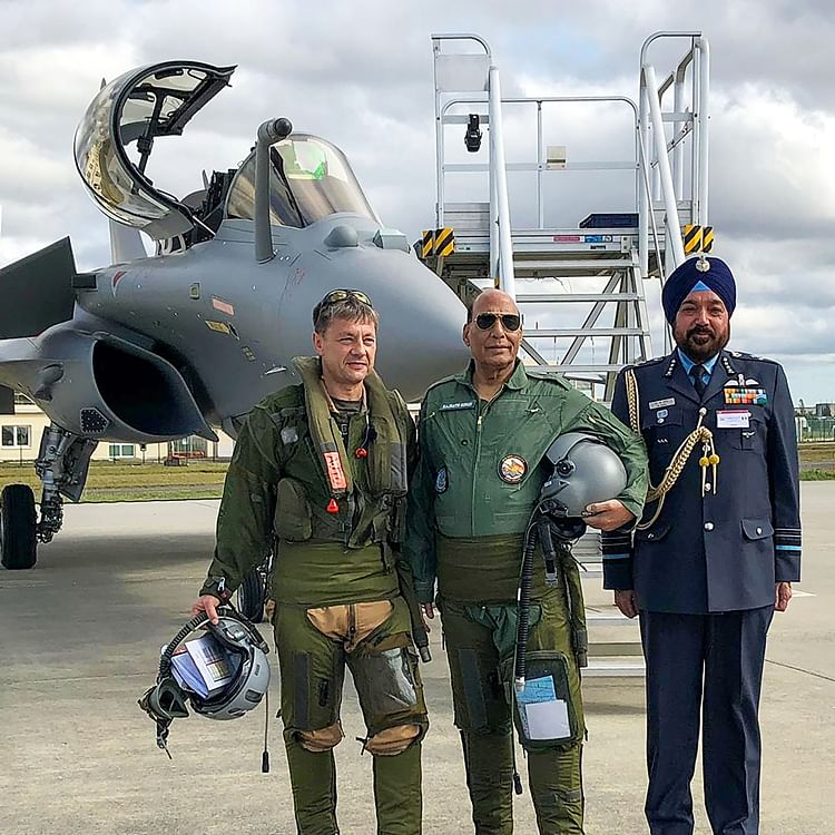 Rajnath Singh performs Shastra Puja, flies Rafale sortie in France