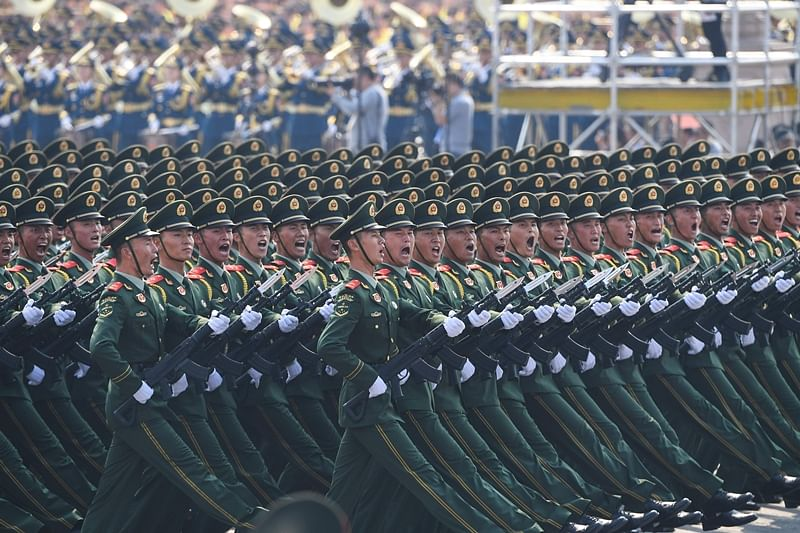 Chinese troops march during a military parade in Tiananmen Square in Beijing on October 1, 2019, to mark the 70th anniversary of the founding of the People's Republic of China. (Photo by Greg BAKER / AFP)