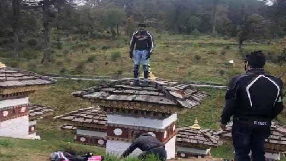 Indian tourist sparks fury after climbing atop scared monument in Bhutan, detained