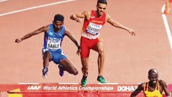 Athletes in action during the steeplechase